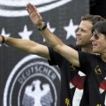 Germany's team manager Bierhoff and head coach Loew applaud fans during celebrations at 'fan mile' in Berlin
