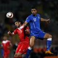 Malta's Ryan Camilleri (L) and Italy's Graziano Pelle fight for the ball during their Euro 2016 Group H qualifying soccer match at the National Stadium in Ta' Qali, outside Valletta, October 13, 2014. REUTERS/Darrin Zammit Lupi (MALTA - Tags: SPORT SOCCER) MALTA OUT. NO COMMERCIAL OR EDITORIAL SALES IN MALTA